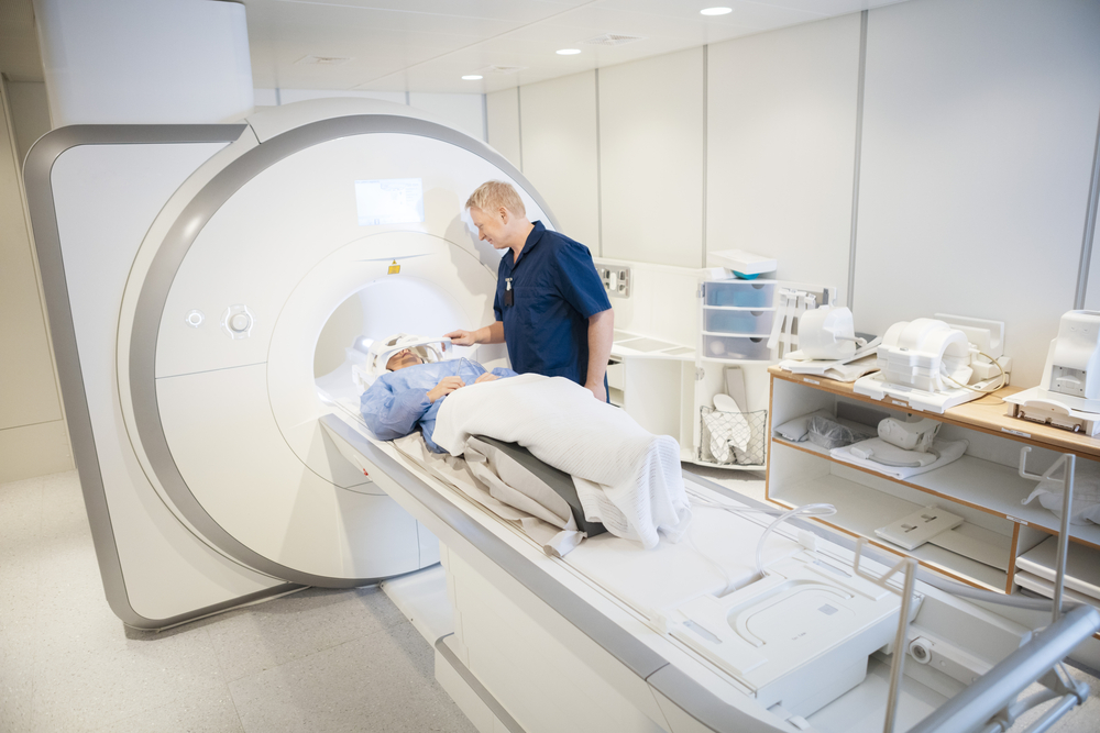Older man being set up in an MRI for a brain scan