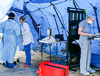 health workers in a tent