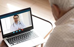 senior talking to health provider on computer
