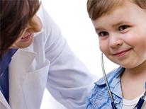 doctor talking to a little boy