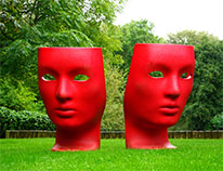 two red face sculptures