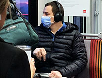 man wearing face mask on bus