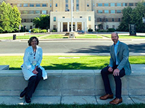 Drs. Kutner Brumbaugh sitting in front of Fitzsimons Building