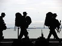 soldiers with backpacks