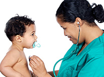 doctor with small child on exam patient