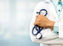 white coat holding stethoscope
