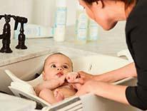 Woman bathing baby