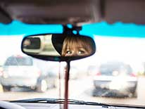 Woman's eyes in rear view mirror