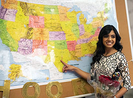 Student from Match Day ceremony 2019 pointing at her residency site on a map
