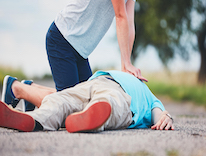 Person giving CPR to person with cardiac arrest
