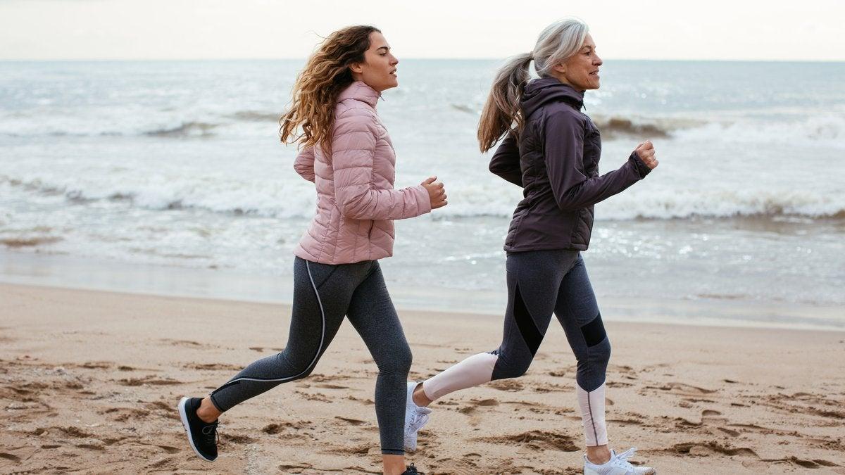 woman-daughter-running-beach
