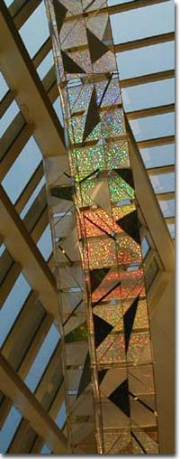 sculpture with glass facade refelecting light