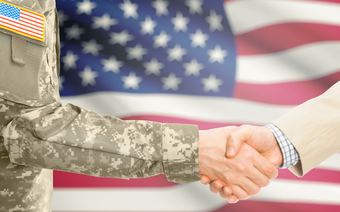 Picture of soldier and civilian shaking hands