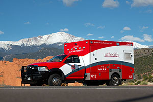 Ambulance parked in front of snowy mountain