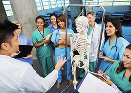teacher with skeleton and several students