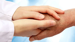 Doctor's hands holding patient's hands