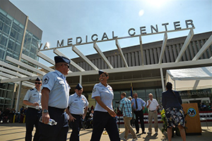 VA medical center with people walking in front of it