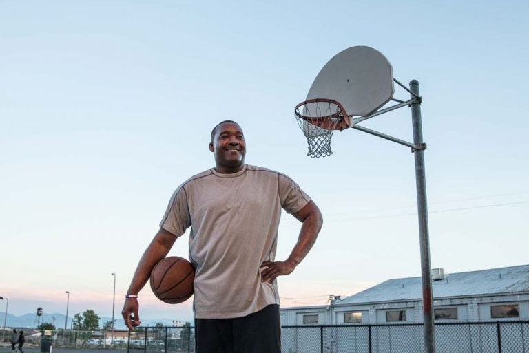 Army 1st Sgt. Jandl Scott enjoys playing basketball after doctors saved his leg following a high-speed car crash.