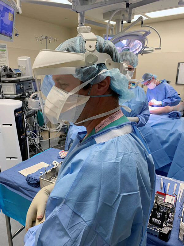 Covid-19, Dr. Jason Stoneback with added virus protection in the UCHealth University of Colorado Hospital