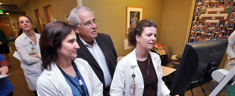 Dr. Kam with Transplant Fellows and Staff
