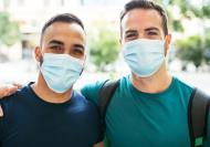 Picture of two men wearing surgical masks