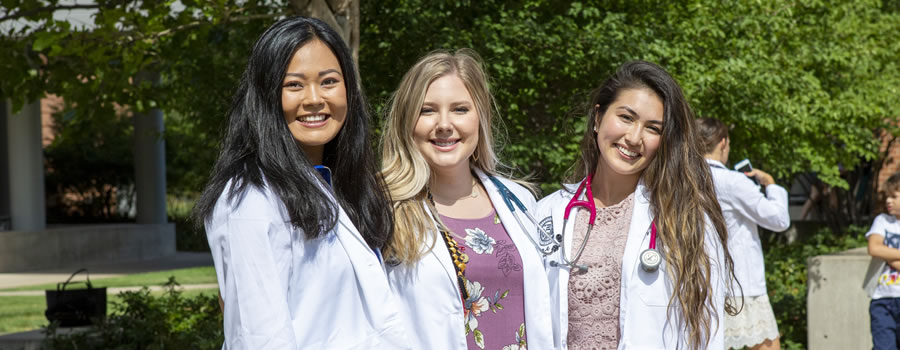 Three PA students on the Anschutz Medical Campus