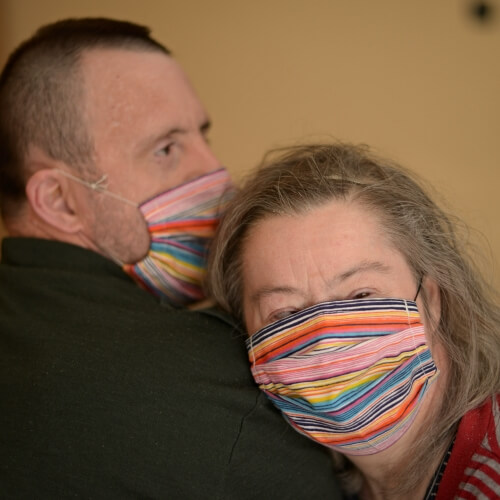 Couple with Down syndrome wearing masks